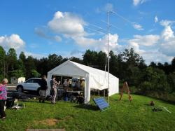 Image of AARC Field Day station 2013 Showing radio tents, antennas, and solar panel