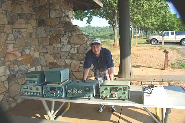 Jim Owen K4CGY and estate sale table of radios